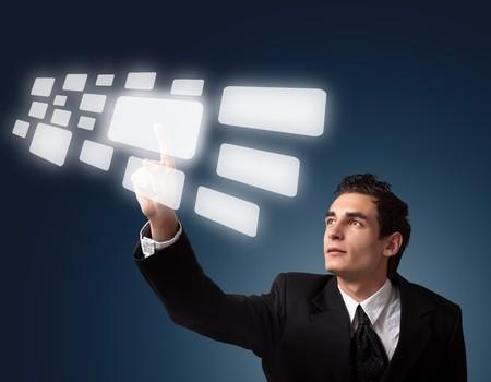 Photo pour Business man pressing a touchscreen button.  - image libre de droit