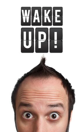 Funny Young man with wake up sign over head, isolated on white background