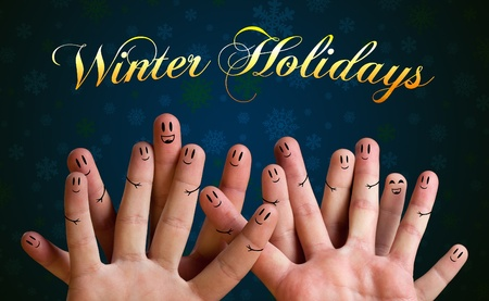 Winter holidays happy finger group with smiley faces
