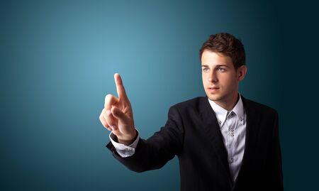 Businessman pressing an imaginary button on bokeh