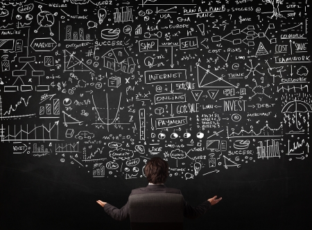Photo pour Young businessman sitting in office chair in front of a blackboard with sketched charts and signs - image libre de droit