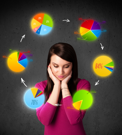 Thoughtful young woman with colorful pie charts circulating around her head