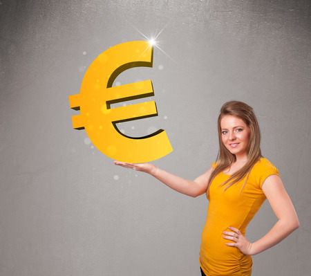 Beautiful young girl holding a big 3d gold euro sign