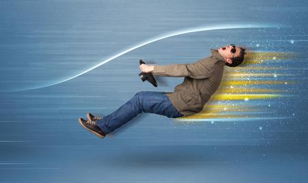 Foto de Young man driving in imaginary fast car with blurred lines concept - Imagen libre de derechos