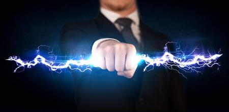 Photo pour Business man holding electricity light bolt in his hands concept - image libre de droit