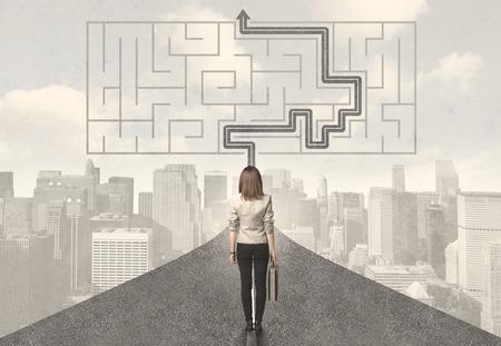 Photo pour Business woman looking at road with maze and solution concept - image libre de droit