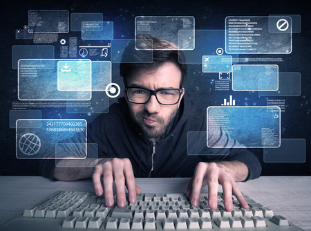 Foto de A confident young hacker working hard on solving online password codes concept with a computer keyboard and illustrated digital screen, numbers in the background - Imagen libre de derechos