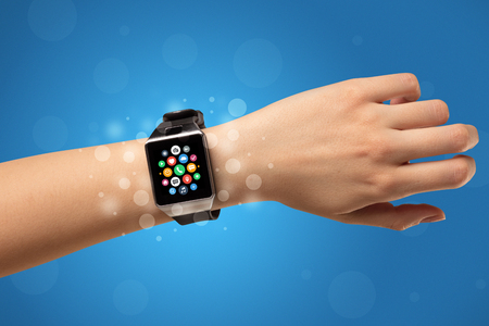 Naked female hand with smartwatch and with application icons on it