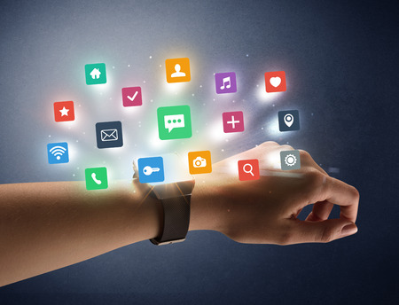Naked female hand with smartwatch and  application labels around and dark background