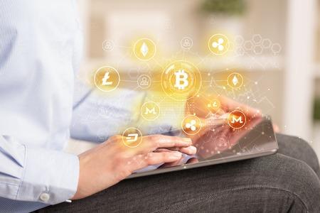 Photo pour Business woman using tablet with bitcoin link network concept - image libre de droit