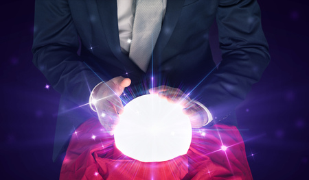 Photo pour Businessman sitting with crystal ball in action - image libre de droit