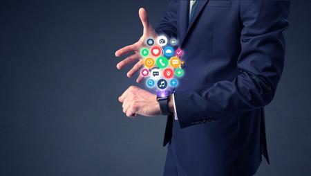 Businessman wearing smartwatch.