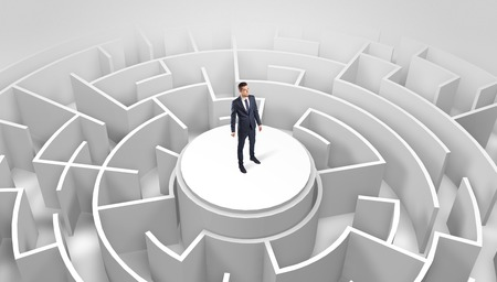 Photo pour Businessman standing on the top of a maze - image libre de droit