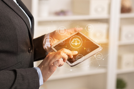 Business woman using tablet with cloud technology concept