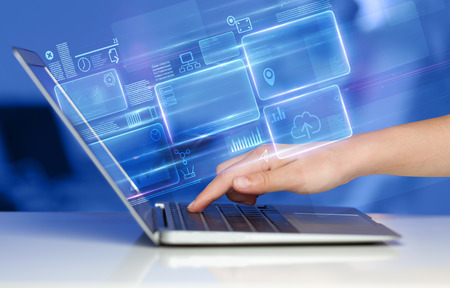 Photo pour Hand using laptop with database reports and online work concept - image libre de droit
