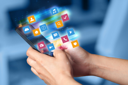 Photo pour Hand using phone with colorful fast moving application icons and symbols concept - image libre de droit