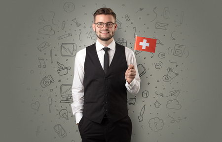 Businessman with office symbol concept and little flag on his hand