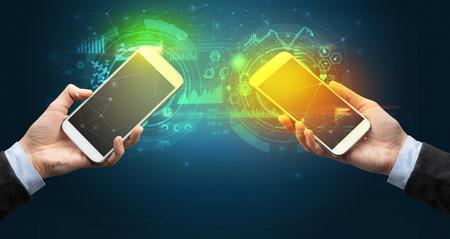 Photo pour Close up of two smartphones, business and communication concept - image libre de droit