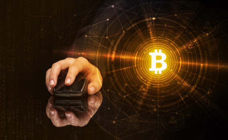 Photo pour Hand using wireless mouse with cryptocurrency concept on dark background - image libre de droit