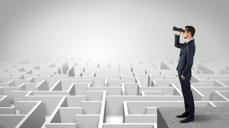 Photo for Businessman standing on maze and looking forward to the future concept - Royalty Free Image