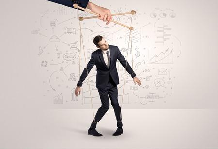 Photo pour Little businessman controlled from above like a puppet concept - image libre de droit