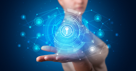 Photo pour Young person holding hologram screen displaying security infomartions - image libre de droit