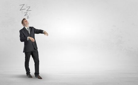 Photo for Tired businessman with sleeping sickness going somewhere - Royalty Free Image