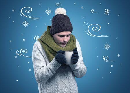 Photo pour Young hipster frozen boy with doodled snowflakes and windy concept - image libre de droit