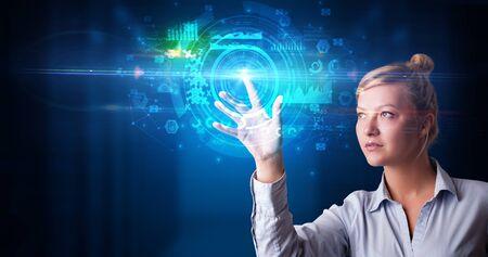 Foto de Woman touching hologram screen displaying medical symbols and charts - Imagen libre de derechos