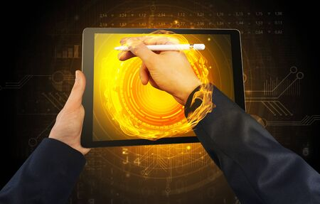 Elegant hand touching tablet with cryptocurrency concept