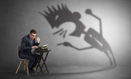 Photo pour Man working hard and he is afraid of a yelling shadow - image libre de droit