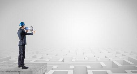 Foto de Architect standing on maze and looking at a future plan - Imagen libre de derechos