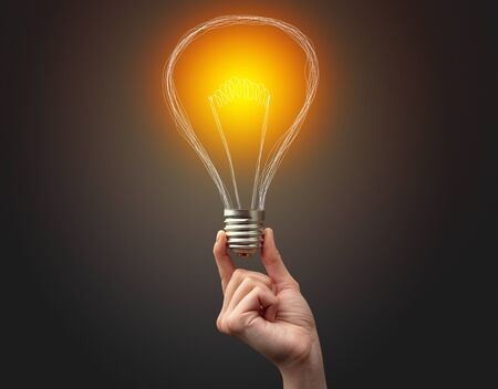 Photo for Hand holding light bulb on dark background. New idea concept - Royalty Free Image