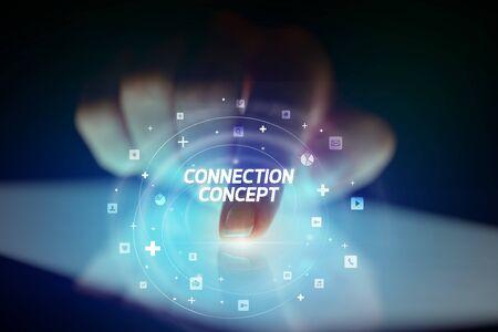 Foto de Finger touching tablet with social media icons and CONNECTI N CONCEPT - Imagen libre de derechos