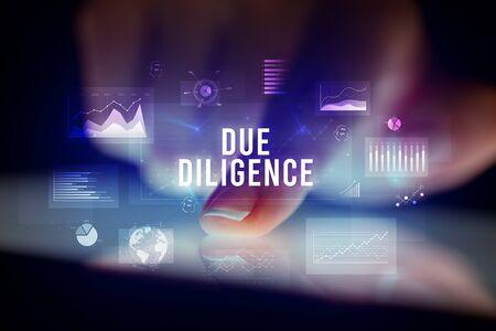 Photo pour Finger touching tablet with charts and DUE DILIGENCE inscription, business concept - image libre de droit