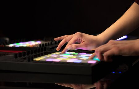Photo for Dj hand remixing music on midi controller - Royalty Free Image