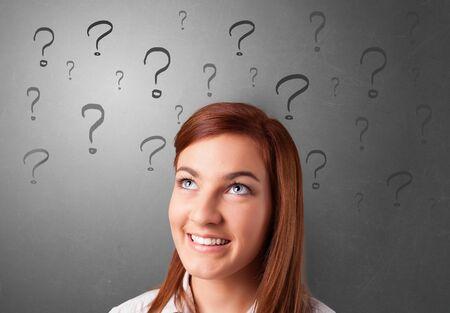 Photo pour Person with question marks around face - image libre de droit