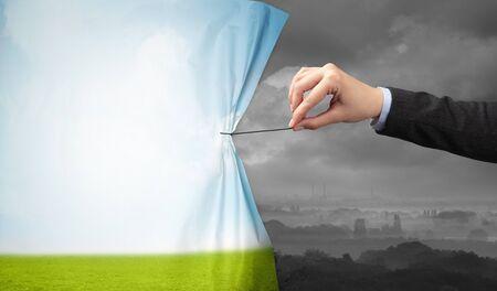Photo pour hand pulling green landscape curtain to gray landscape, environmental protection concept - image libre de droit
