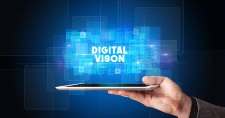 Photo pour Young business person working on tablet and shows the inscription: DIGITAL VISON - image libre de droit