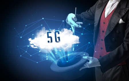 Photo pour Magician is showing magic trick with 5G abbreviation, modern tech concept - image libre de droit