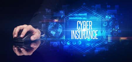 Foto de hand holding wireless peripheral with CYBER INSURANCE inscription, cyber security concept - Imagen libre de derechos