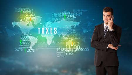 Photo pour Businessman in front of a decision with TAXES inscription, business concept - image libre de droit
