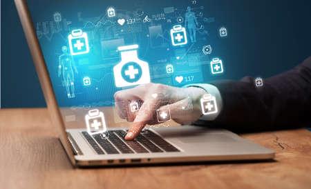 Foto für hand browsing on the internet for medical issues - Lizenzfreies Bild