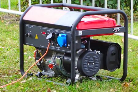 Photo for Working portable electric generator on green grass - Royalty Free Image