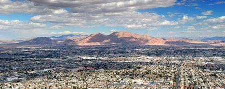 Las Vegas Aerial Panorama with city skyline, mountain and streets.