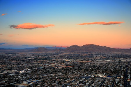 Urban city of Las Vegas aerial view at sunset with mountain.