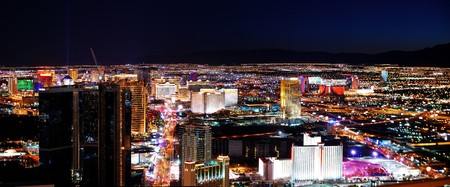 Las Vegas strip at night. Las Vegas City Skyline panorama with sunset, mountain, luxury hotels and streets.