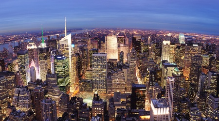 New York City Manhattan Times Square night city skyline aerial view with urban skyscraper illuminated.