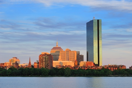 Boston Charles River with urban city skyline at sunset