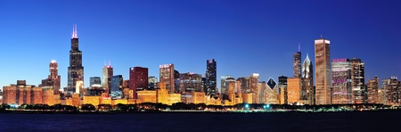 Chicago city downtown urban skyline panorama at dusk with skyscrapers over Lake Michigan wit